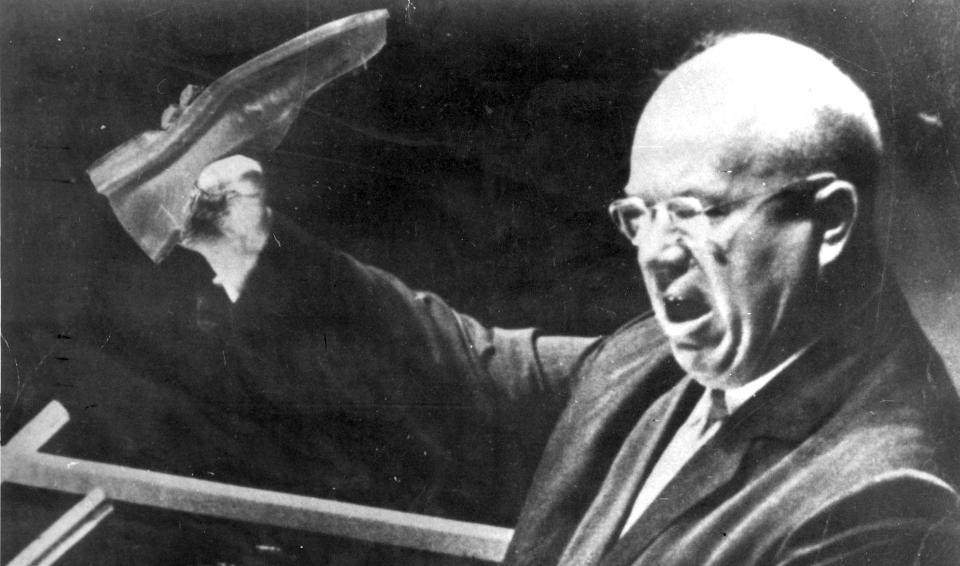Khrushchev holding his shoe